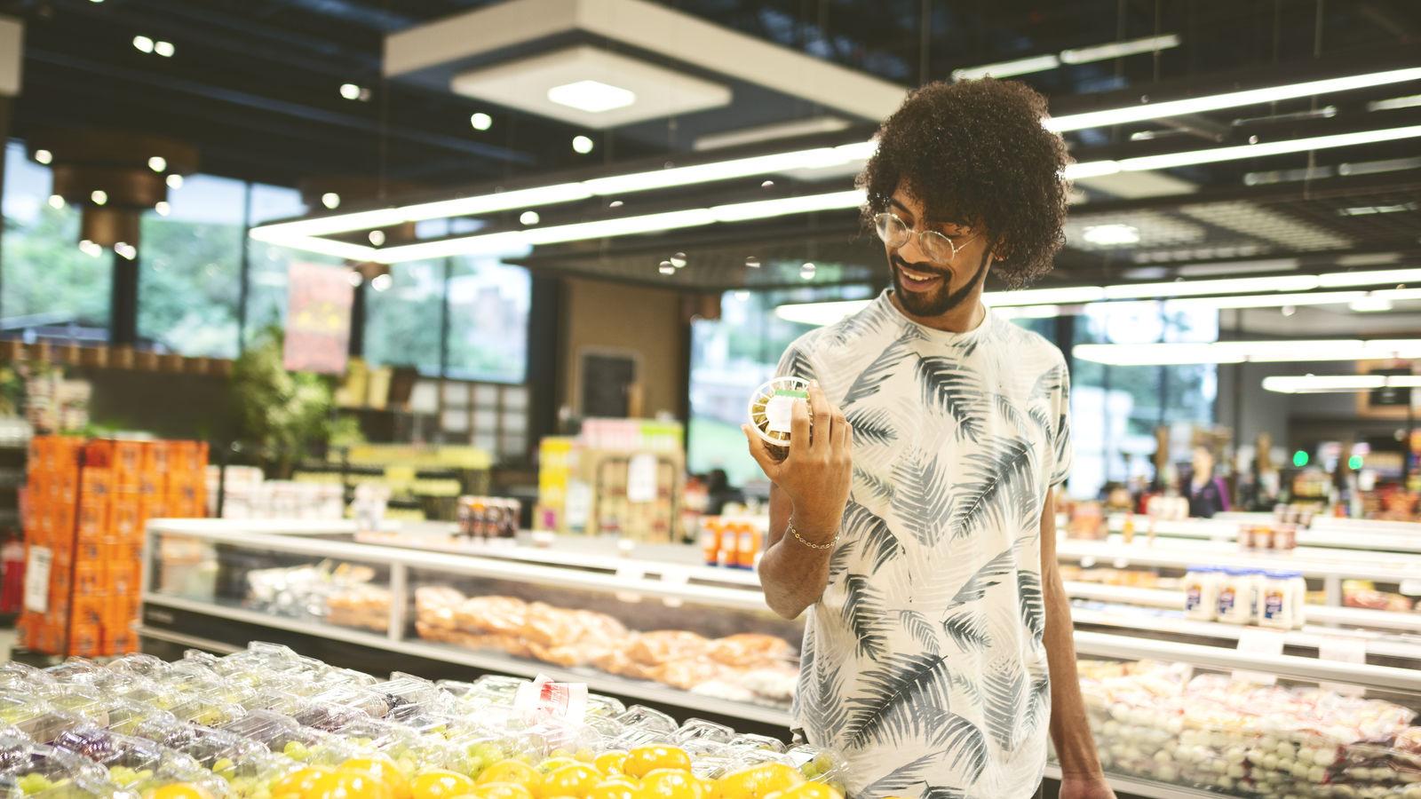 Young man at super market.