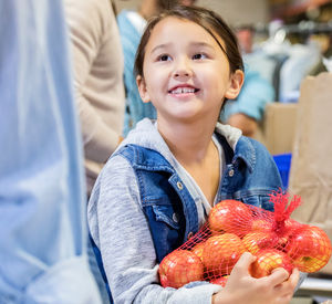 Girl with apples at food bank.