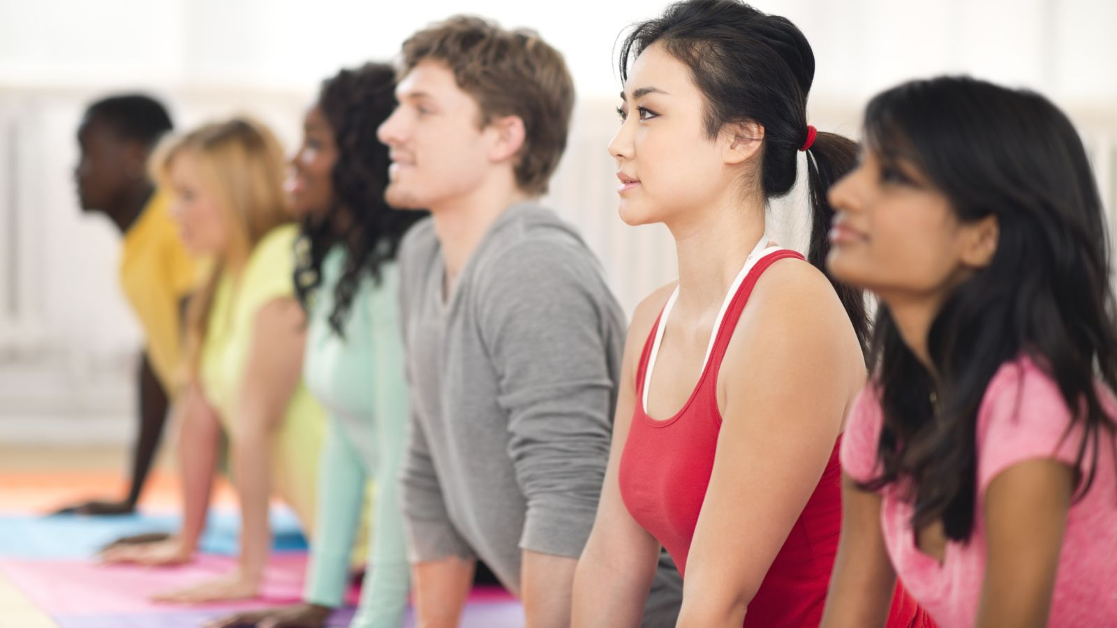 College students doing yoga as part of program to combat college obesity.
