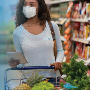 Woman in grocery store with mask