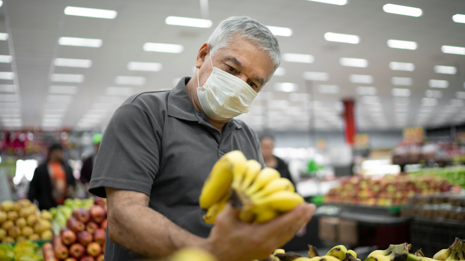 Shopper looking for healthy food in grocery store.