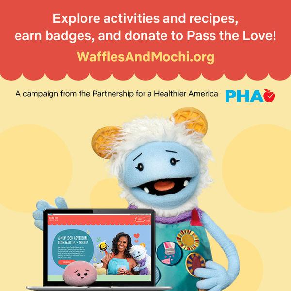 An image of Waffles and Mochi looking at the wafflesandmochi.org website