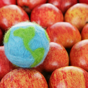 A globe with red apples