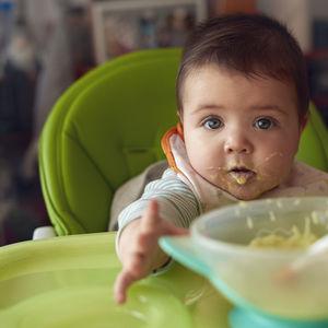 baby eating green vegetables