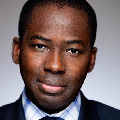 Portrait of PHA Board Member Olajide Williams.