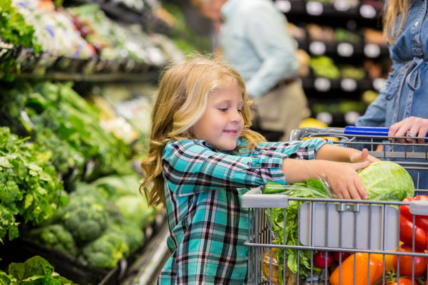 Family in grocery store making the healthy choice the easy choice.