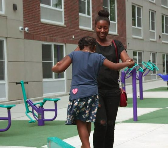 Kiana and her mother at Blue Sea Development's Prospect Plaza housing, a development that utilizes active design strategies.