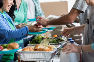 Image of a person receiving a healthy meal at food bank.