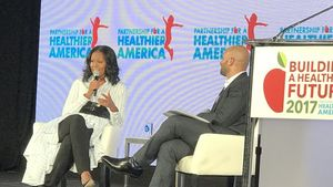 Michelle Obama and Sam Kass speaking at PHA's 2017 Building a Healthier Future Summit, featured in NPR.