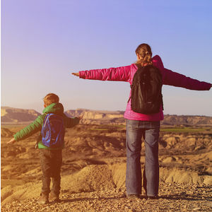 Image of a mother and child standing on top of a mountain.