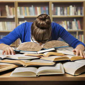Image of a stressed college student with their head down on a large pile of textbooks.