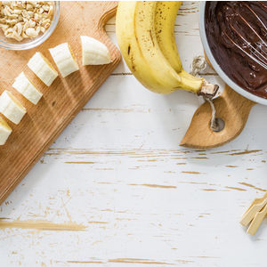 Image of bananas and chocolate for Westin's recipe for Chocolate-Covered Banana Lollipops.