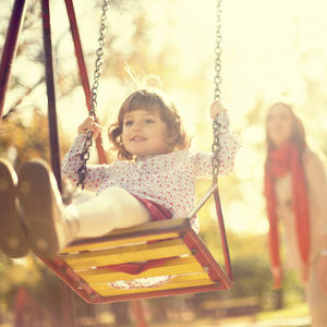 Image of a child on a swing.