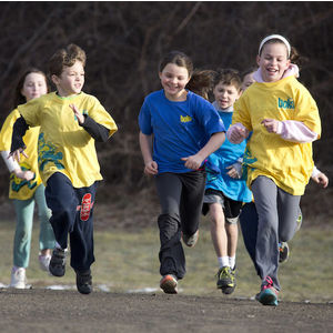 Image of children running across a field. These are participants in a children's physical activity program through BOKS.