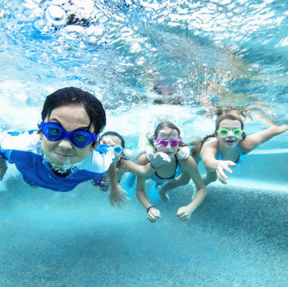Image of children swimming underwater.