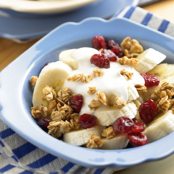 Image of Craisins® Crunch Breakfast Bowl with bananas, low-fat yogurt, granola and dried cranberries.