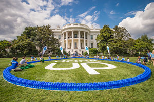 Image of Nalgene water bottles with Partnership for a Healthier America's Drink Up initiative logo displayed on the White House lawn during the campaign's anniversary celebration.
