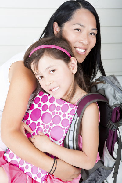 Image of a mother hugging her child on the first day of school.