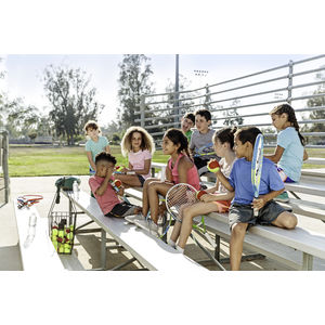 Image of a group of elementary school students sitting on bleachers with tennis gear and equipment. Image from USTA's NET Generation initiative for PHA's 2017 #PHABack2School campaign.