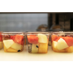 Image of fresh cut fruit in plastic packaging at a convenience store.
