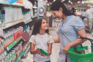 Image of a daughter and mother shopping in a grocery store.
