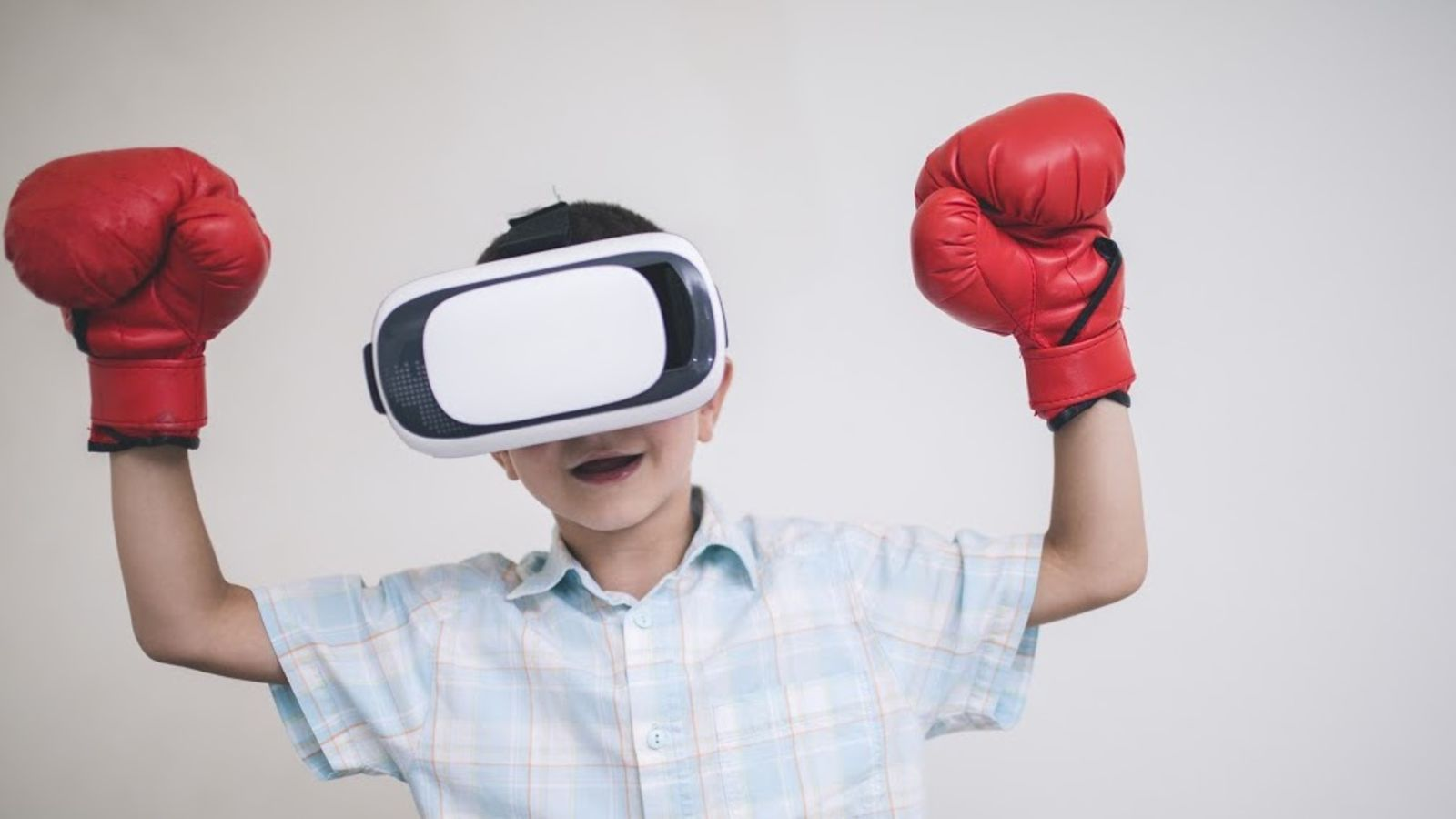 Image of a young boy playing a virtual reality game.