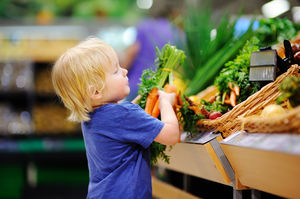 Young boy picking out carrots