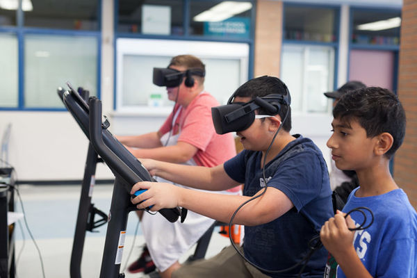 Image of three children playing a Blue Goji virtual reality game.