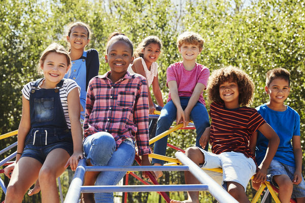 Image in Partnership for a Healthier America's 2017 Progress Report of children playing on an outdoor playground.
