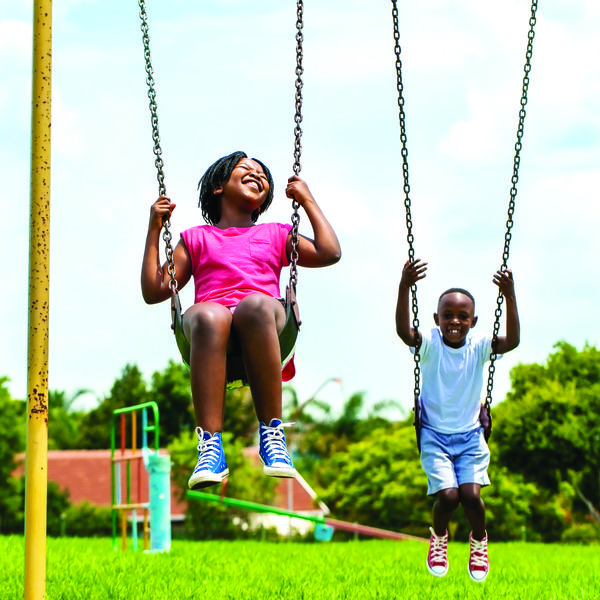 Image of two children on a swing.