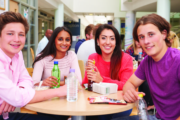 Image of students in the cafeteria at a college.